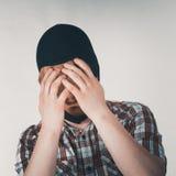 Sad man wearing balaclava. Sad distraught thief wearing black balaclava. Tired man being angry at himslef Stock Image