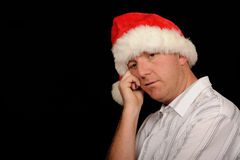 Sad Man Wearing Santa Hat Stock Photos