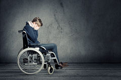 Sad man in wheelchair Stock Photography