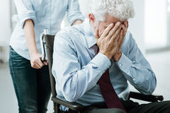 Sad man in wheelchair Royalty Free Stock Images