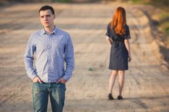 Sad man and woman stand on the dirt road Royalty Free Stock Photo