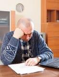 Sad man at work Stock Photography