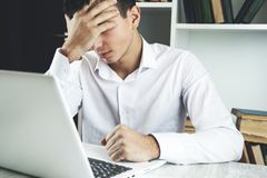 Sad man in office royalty free stock photo
