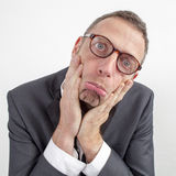Sad manager disappointed by corporate announcement expressed with humor Stock Images