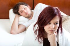 Sad marriage in the morning. Sad marriage in bed in the morning Stock Images
