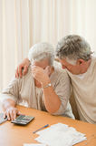 Sad mature couple calculating their domestic bills Stock Photos