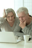 Sad Mature couple with laptop Royalty Free Stock Photos