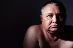 Sad mature man. Dramatic close-up portrait of pensive middle aged man stock photo