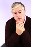 Sad mature man with grey hair Stock Images
