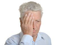 Sad mature man. Holding his head with hand stock photo