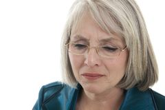 Sad mature woman Stock Images