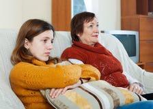 Sad mature woman and adult daughter Stock Photos