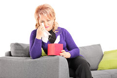 Sad mature woman crying and wiping her tears Royalty Free Stock Images