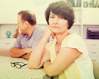Sad mature woman experiencing family problems Stock Photo