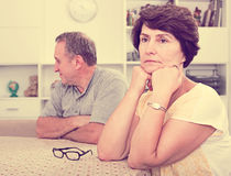 Sad mature woman experiencing family problems Royalty Free Stock Image