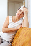 Sad mature woman having headache Royalty Free Stock Photography
