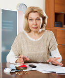 Sad mature woman thinking Royalty Free Stock Photography