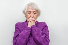 The melancholy senior woman. The sad and melancholy senior woman on white studio background or at home Stock Photography