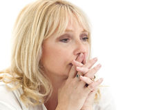 Sad middle aged lady thinking with hands locked Royalty Free Stock Photo