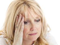 Sad middle aged lady touches her head Royalty Free Stock Images