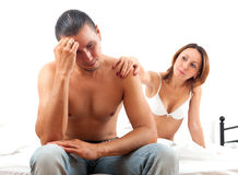 Sad middle-aged man has problem, a wife comforting him Royalty Free Stock Photos