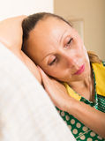 Sad middle-aged woman at home Royalty Free Stock Images
