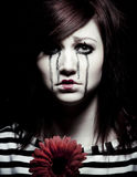 Sad mime. A sad female mime clown with a red flower Royalty Free Stock Images
