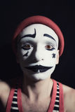 Sad mime on black Stock Photography