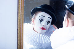 Sad mime Pierrot looking at the mirror royalty free stock photos