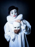 Sad mime Pierrot with a mask Royalty Free Stock Images