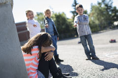 Elementary Age Bullying in Schoolyard Stock Photography