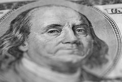 Sad Money. Closeup of hundred dollar bill isolated on white background with frown on face Stock Image