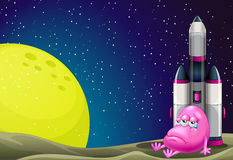 A sad monster beside the rocket in the outerspace Stock Photography