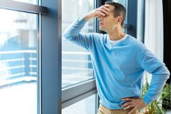 Sad moody man looking into the window Royalty Free Stock Photo