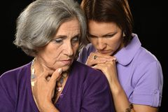 Sad mother and daughter stock photos