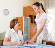 Sad  mother and daughter with  documents Royalty Free Stock Image