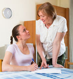 Sad mother and daughter with  documents Royalty Free Stock Photos