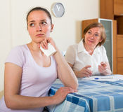 Sad mother and daughter with  documents Stock Image
