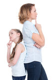 Sad mother and daughter having problem. Or quarrel standing back to back studio isolated on white Stock Photos