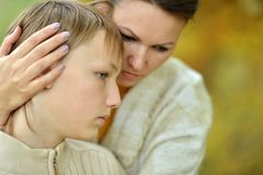 Sad mother with a son Royalty Free Stock Photos