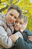 Sad mother with a son Stock Photos