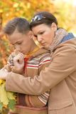 Portrait of sad mother and son in autumn park stock images