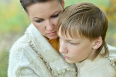 Sad mother with son in park Stock Photo