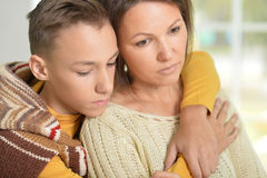 Sad mother and son Stock Images