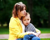 Sad mother and son in summer green park Stock Images