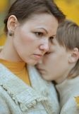 Sad mother with a son Stock Images