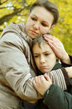 Sad mother with son Royalty Free Stock Images