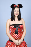 Sad mouse girl. Sad girl dressed in mouse costume with makeup standing straight royalty free stock photo