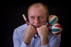 Sad musician with Ukrainian woodwind instrument sopilka and maracas Royalty Free Stock Photo