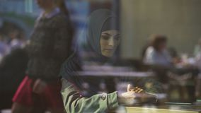 Sad Muslim female in cafe, suffering loneliness, divorce, emigration problems. Stock footage stock video
